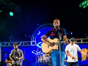 Travis Greene on the guitar